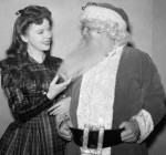 Ida Lupino Playing with Santa's Beard